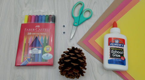 Pine Cone Craft Supplies Including Glue, Pine Cone, Scissors, Washable markers, Construction Paper and Glue
