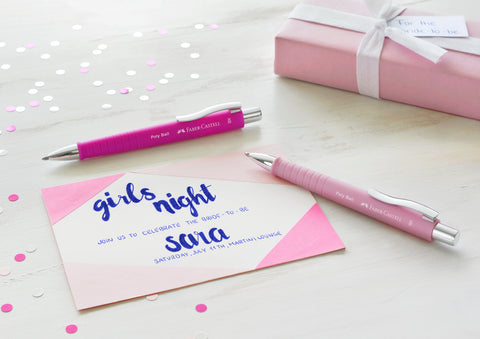Two Poly Ball pens and an invitation