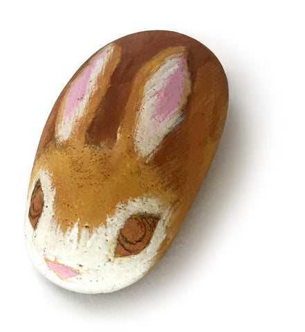 Rock with bunny painted on it