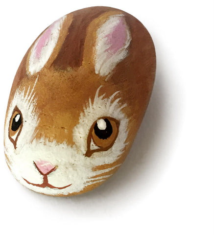 A rock with a bunny painted
