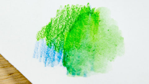Green and blue color pencil with baby oil