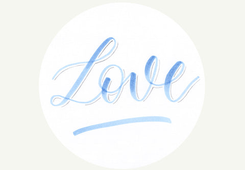 Hand lettered love on white tag