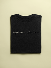 Load image into Gallery viewer, ingénieur du son T-Shirt folded in black