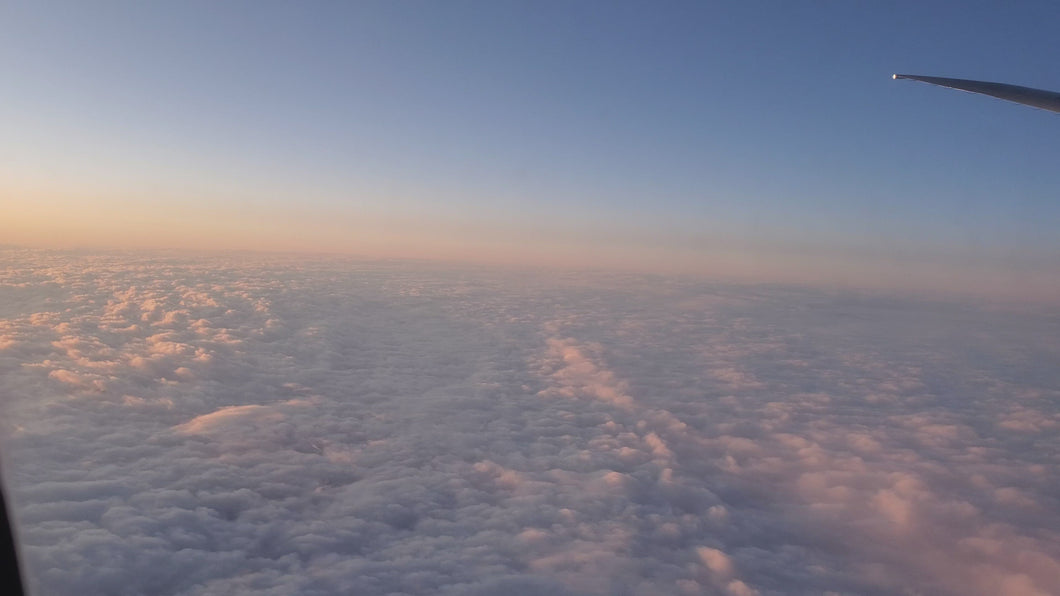 Above the clouds in an airplane daytime