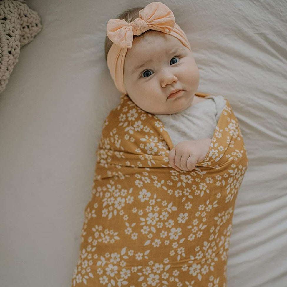 The Mini Scout | Swaddle | Whimsy Floral | Mustard | White Fox & CoThe Mini Scout | Swaddle | Whimsy Floral | Mustard | White Fox & Co
