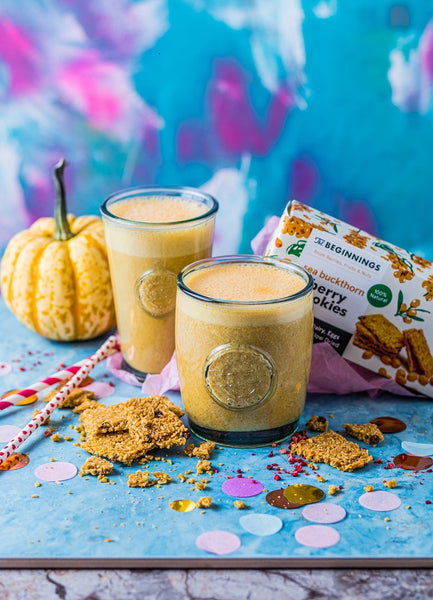 Vegan sea buckthorn-pumpkin smoothie with whipped cream and cookies