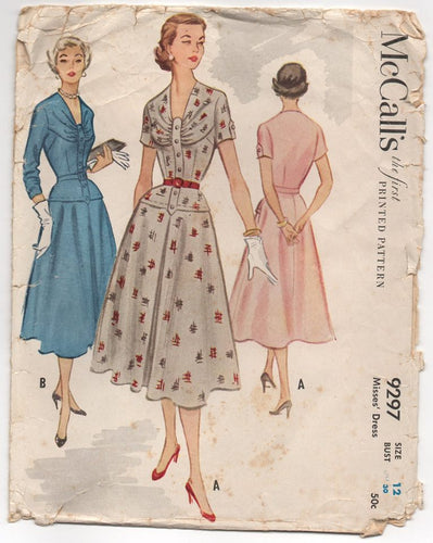 1950's McCall's One Piece Dress with Drop Waist, Draped Front and Tab Accent - Bust 30