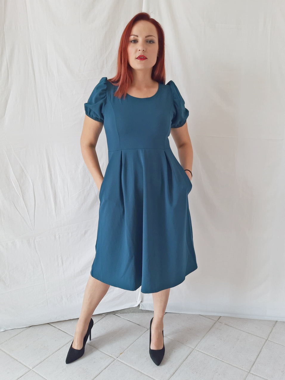 model-wears-a-blue-midi-dress-1