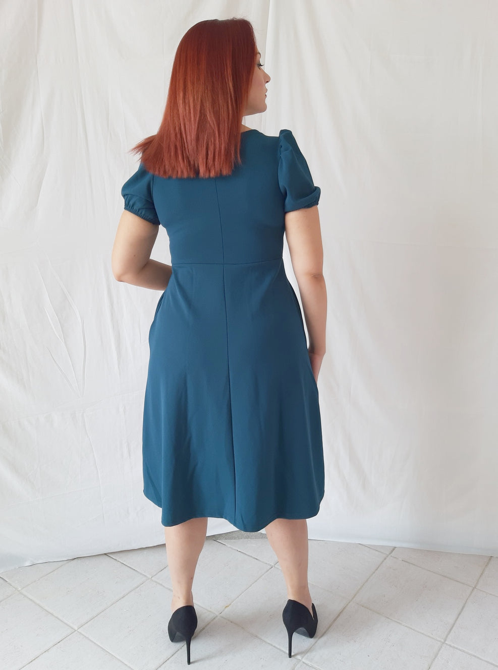 model-wears-a-blue-midi-dress-3