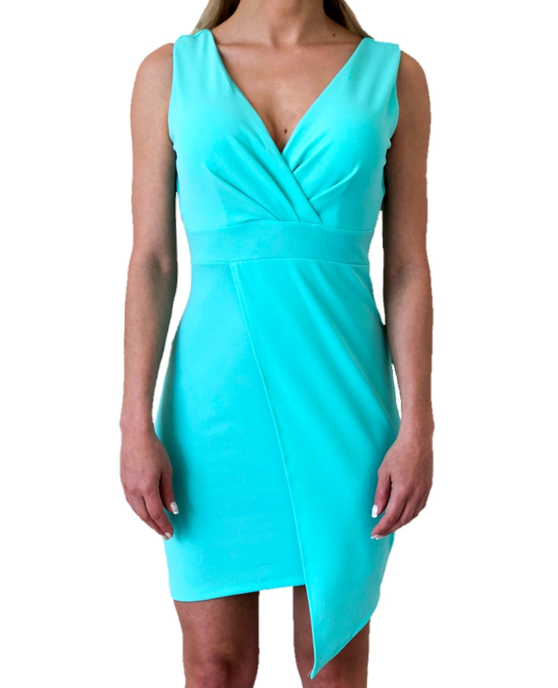 woman-wears-a-mini- turquoise-dress-white-background