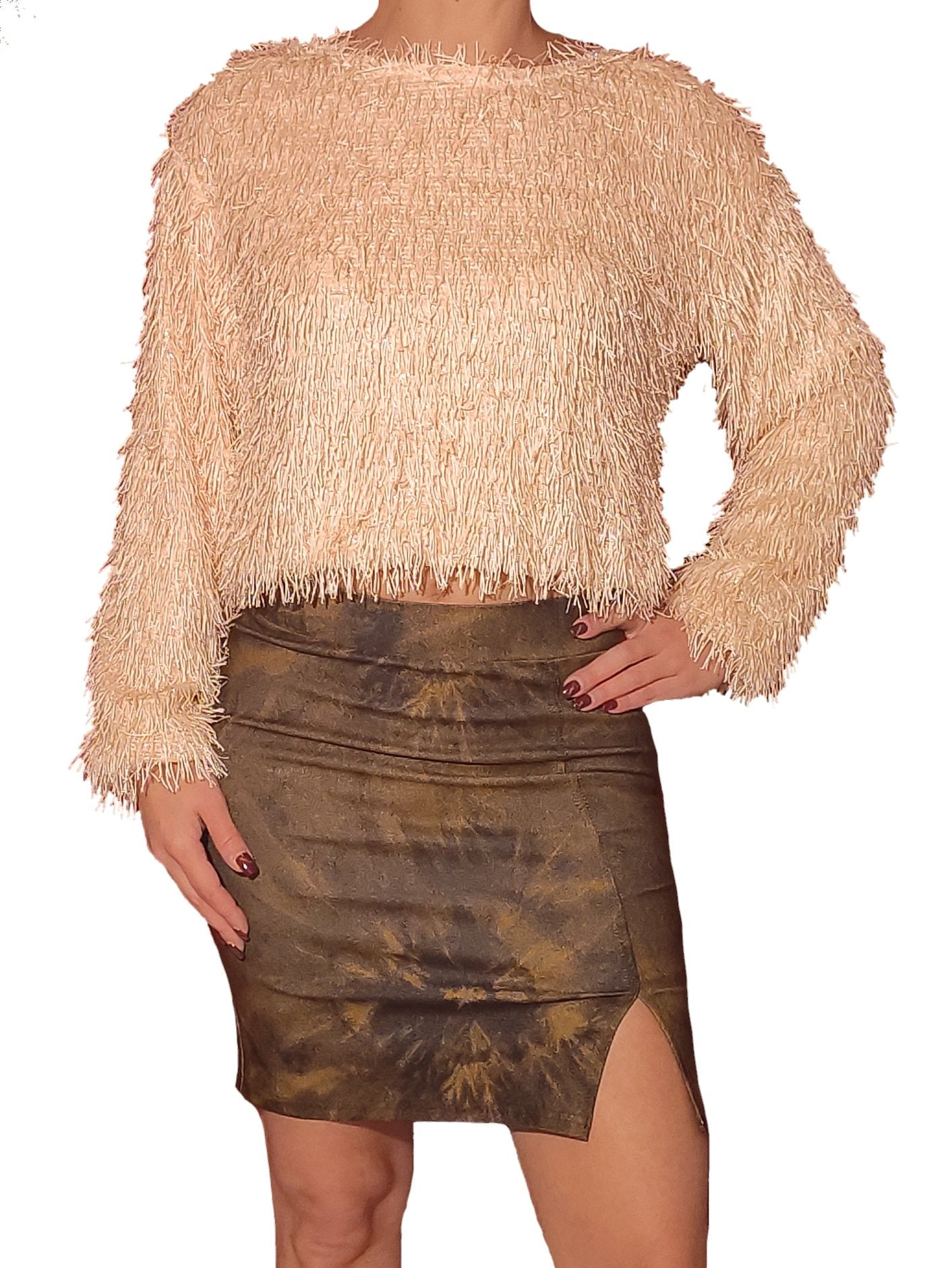 a-girl-wears-a-beige-blouse-with-gold-fringe-frontside