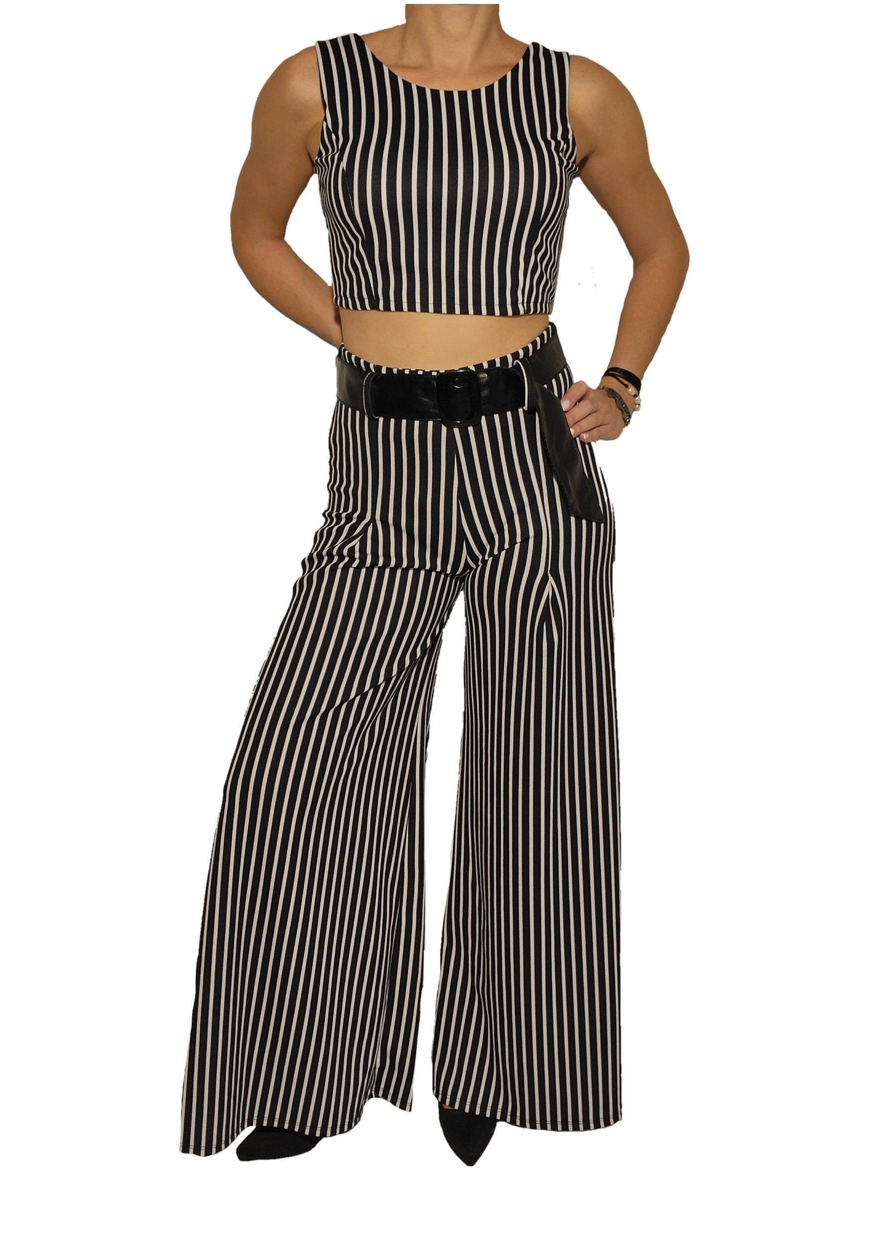a-woman-wears-a-crop-top-and-a-trouser-front-side