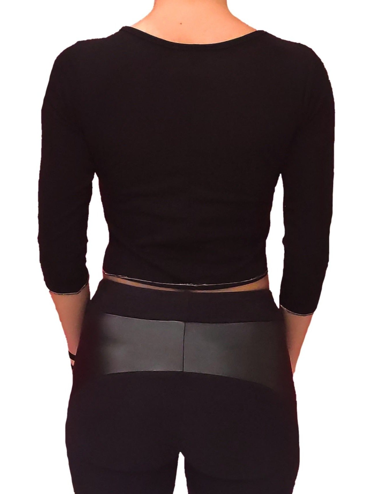a-girl-wears-a-black-blouse-with-longsleeves-back-side