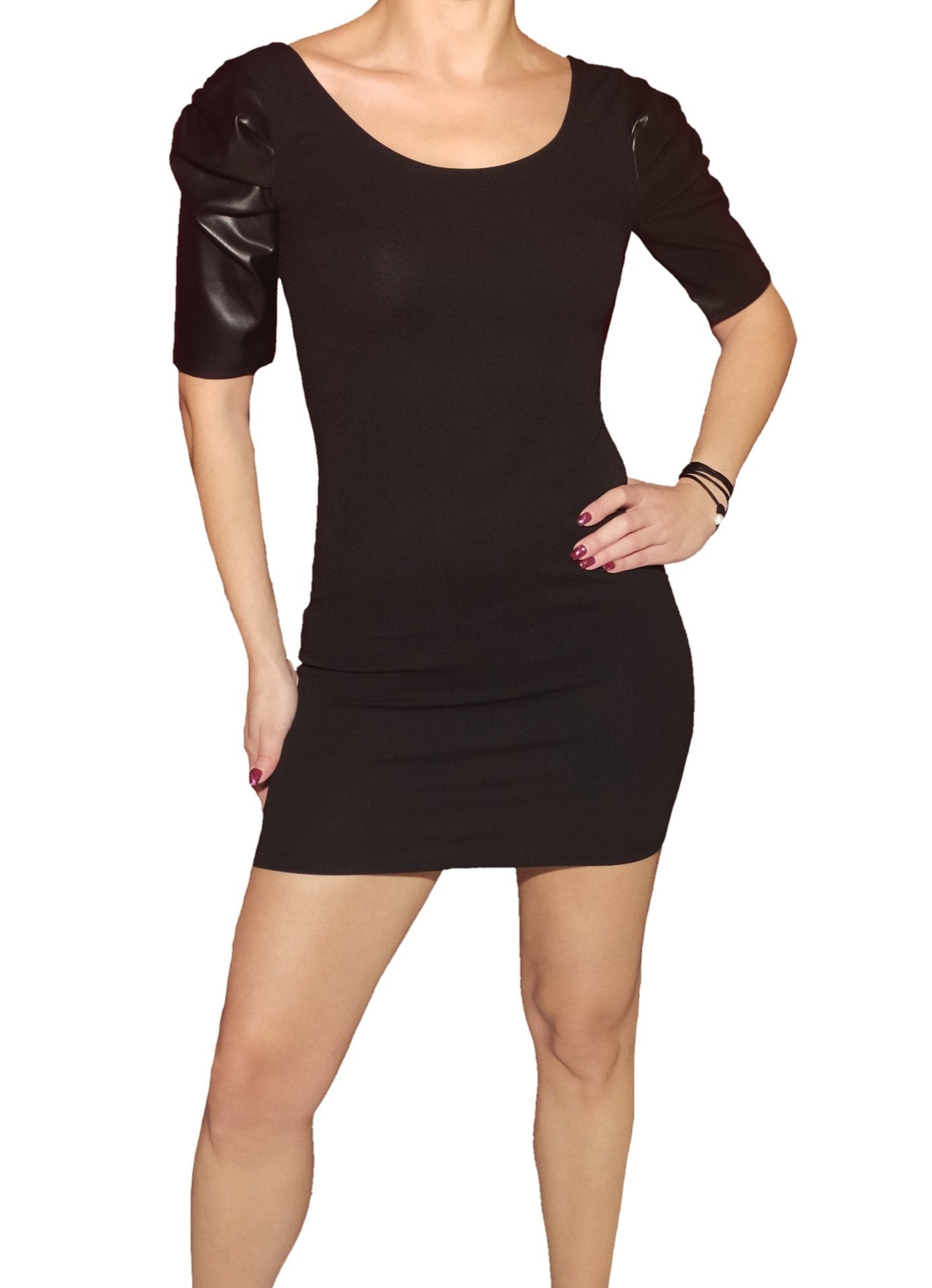 a-girl-wears-a-black-mini-dress-with-leatherin-sleeves-front-side