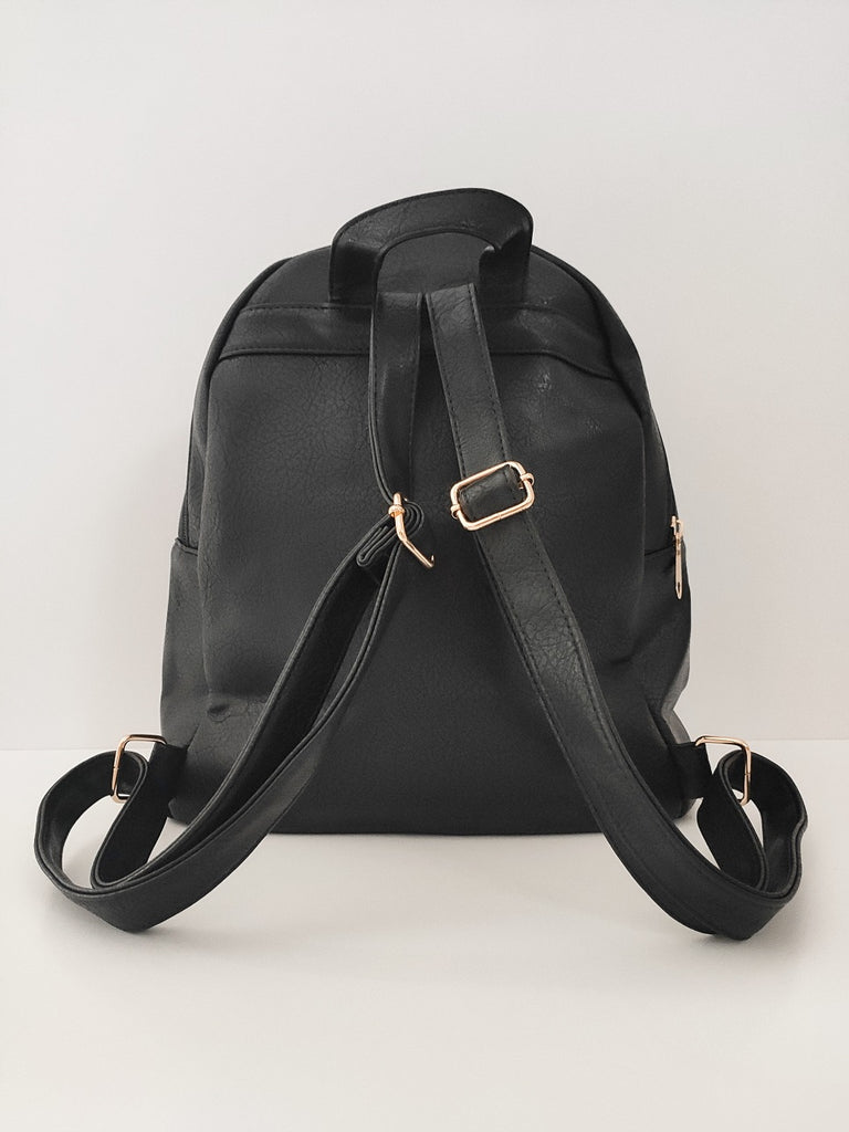 black-jean-backpack-with-zipper-backside-in-a-white-background