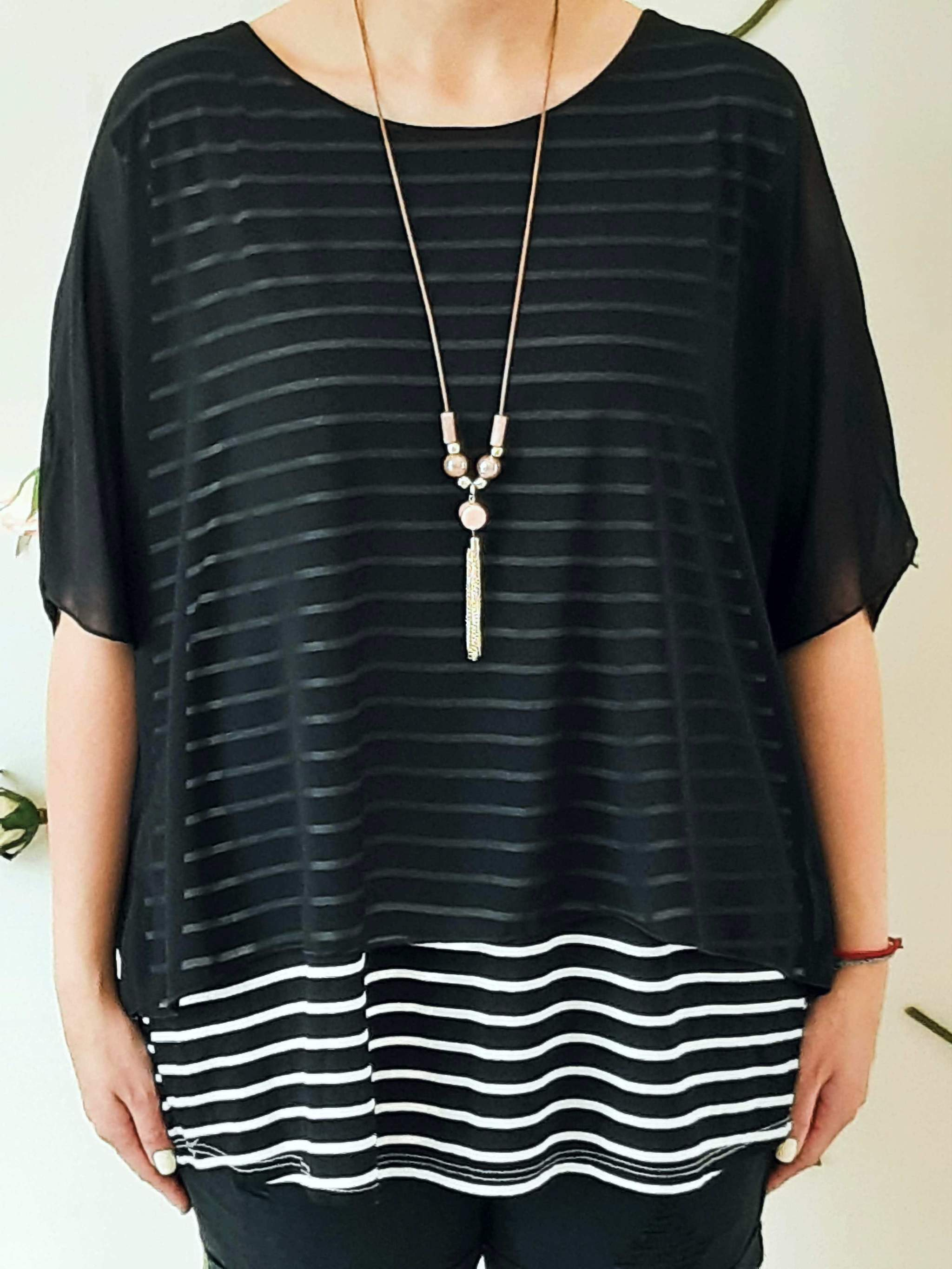 girl-wears-a-black-shirt-with-white-stripes-frontside
