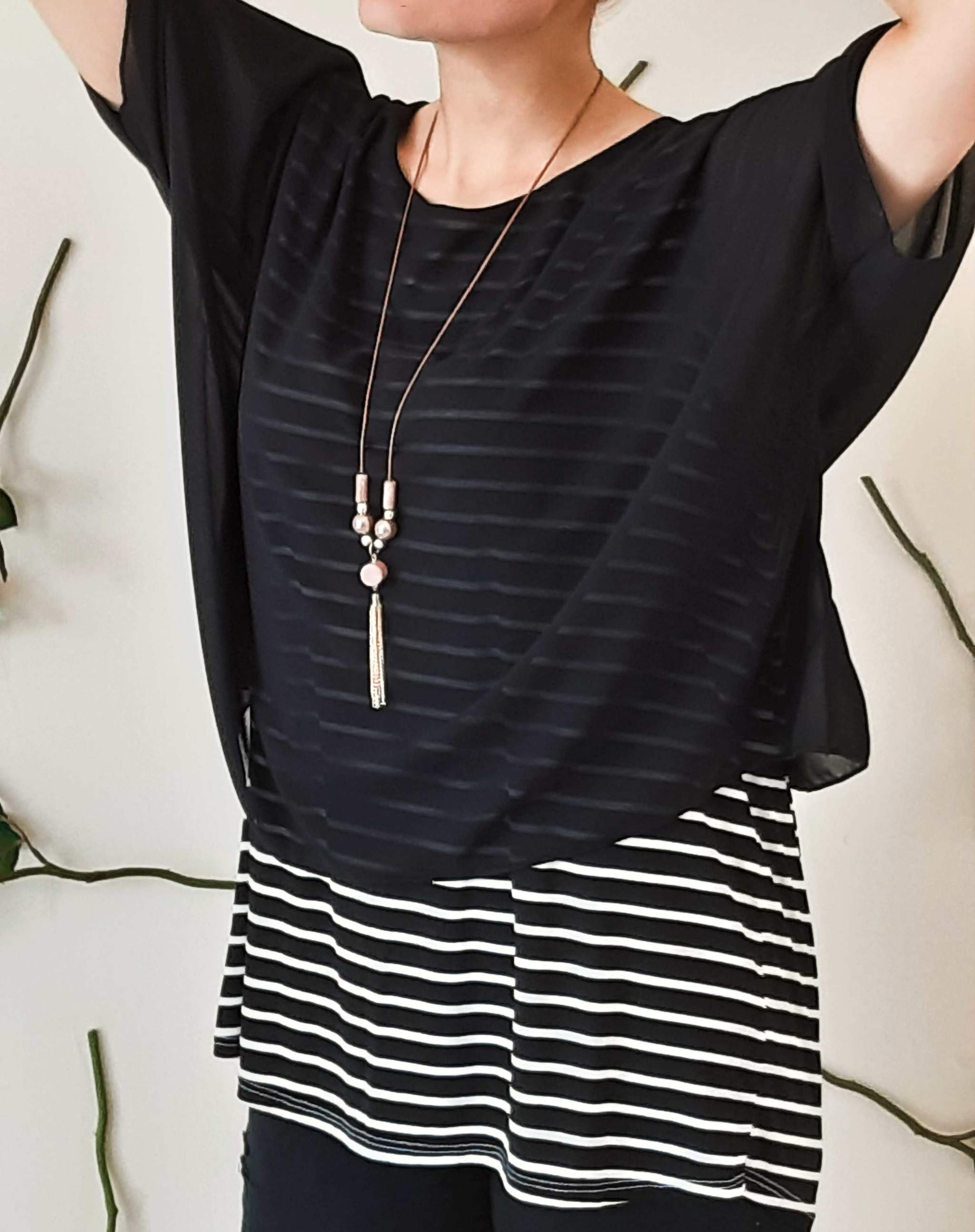 girl-wears-a-black-shirt-with-white-stripes-leftside