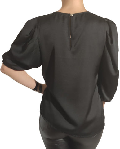 a-woman-wears-a-black-blouse-back-side
