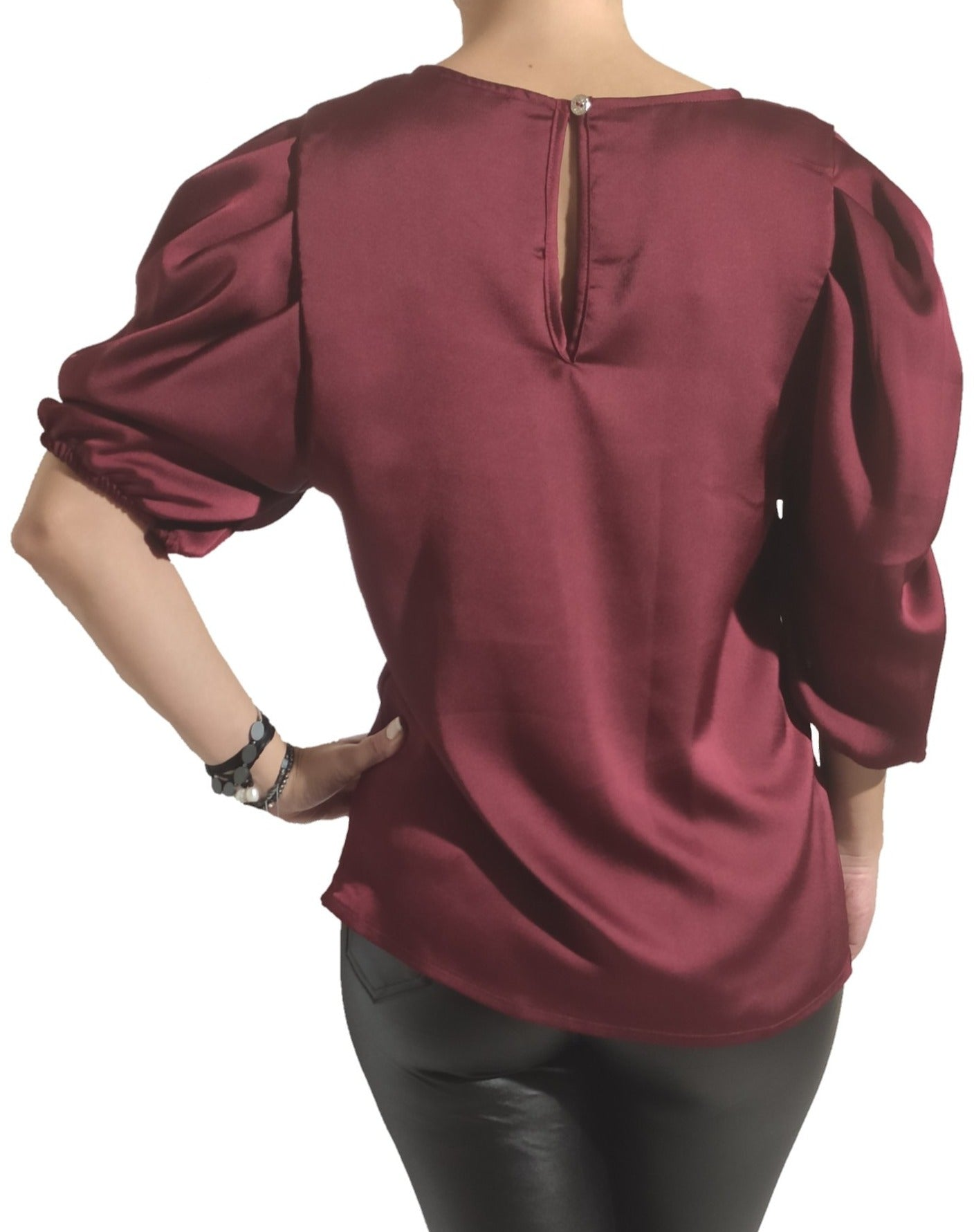 a-woman-wears-a-bordeaux-blouse-back-side