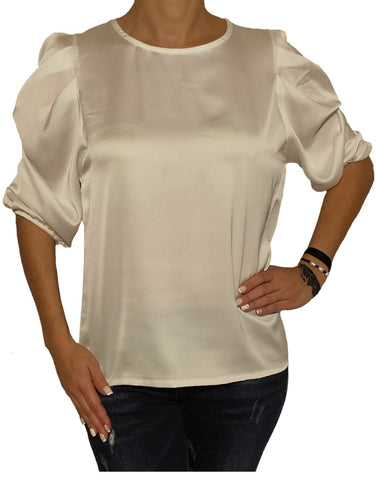 a-woman-wears-a-white-blouse-front-side