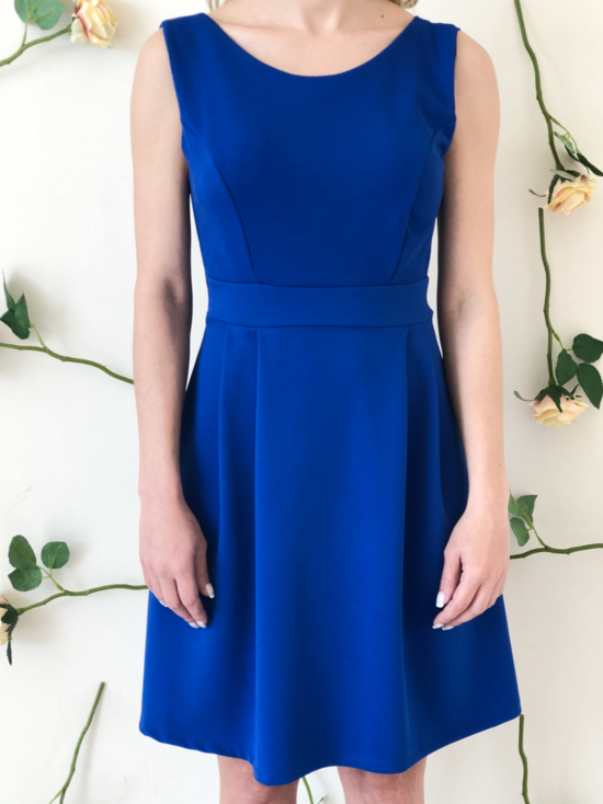 blonde-girl-wears-blue-dress-frontside