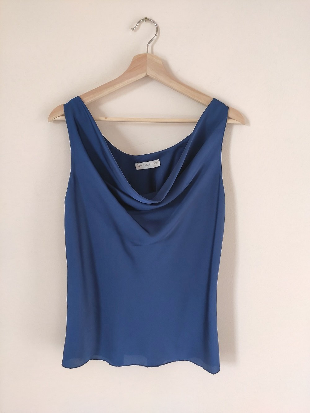 blue-sleeveless-blouse-satin-front-on-a-hanger