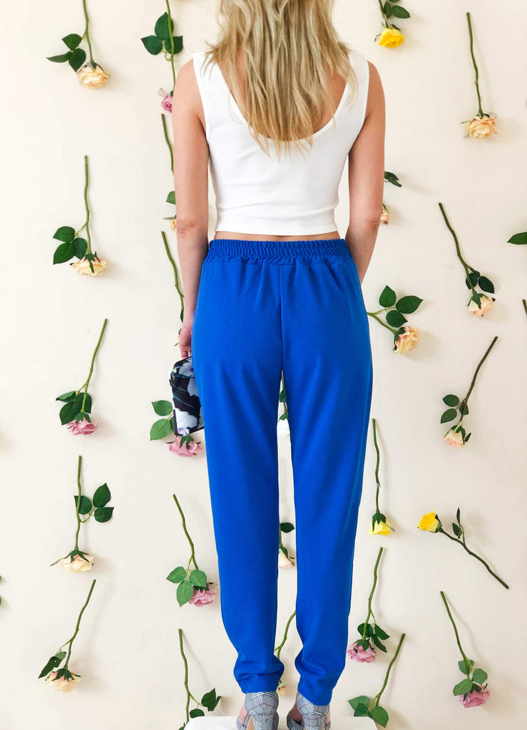 girl-wears-blue-trouser-with-bow-back