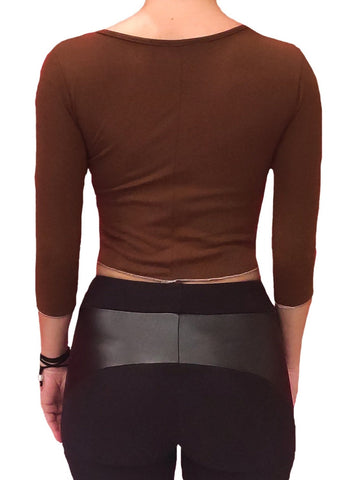 a-girl-wears-a-brown-blouse-with-longsleeves-back-side