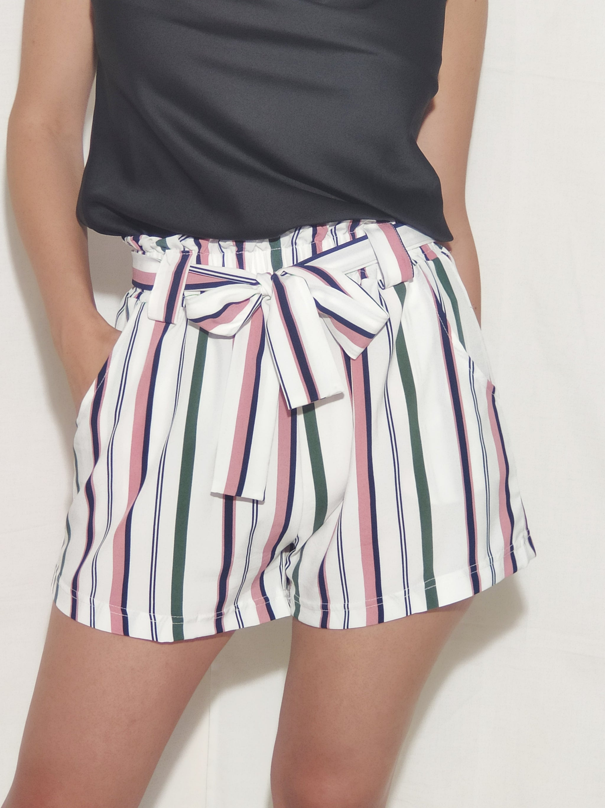 brunet-girl-wears-a-white-shorts-with-stripes-and-bow-frontside-2