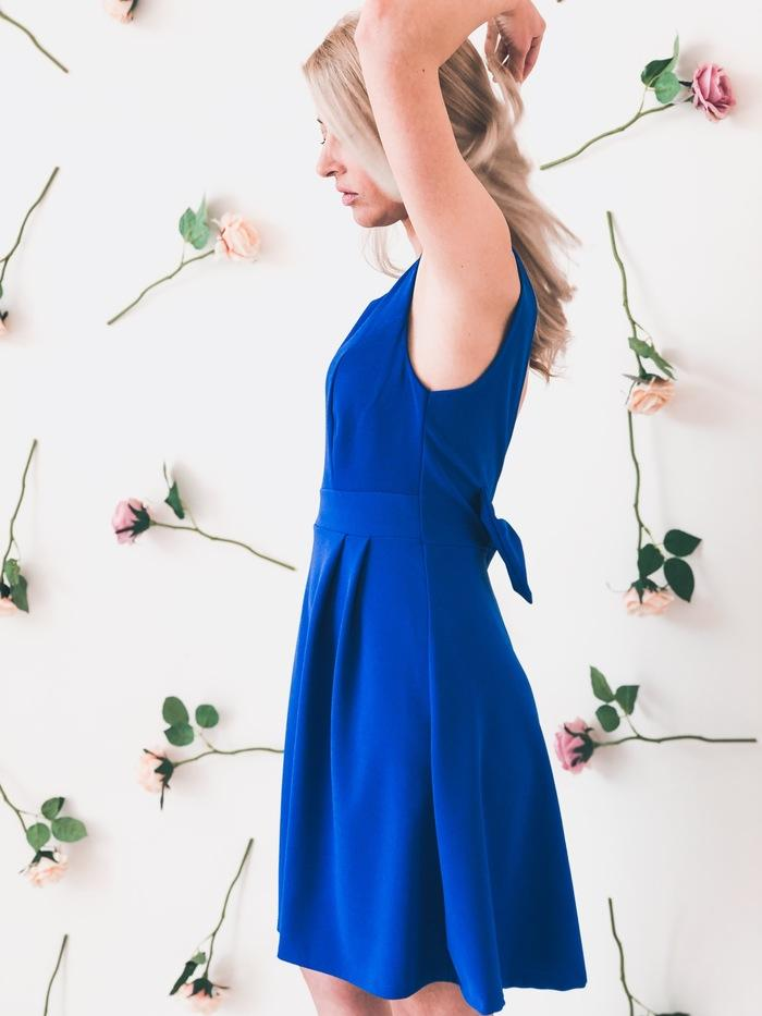 blonde-girl-wears-blue-dress-left-side