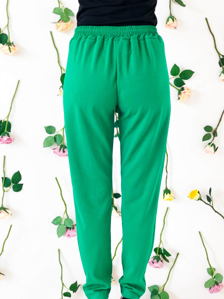 girl-wears-green-trouser-with-bow-back