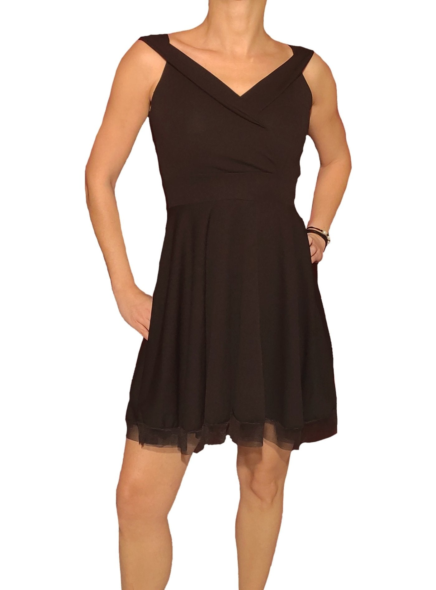 a-woman-wears-a-mini-black-cruaze-dress-with-tul-frontside
