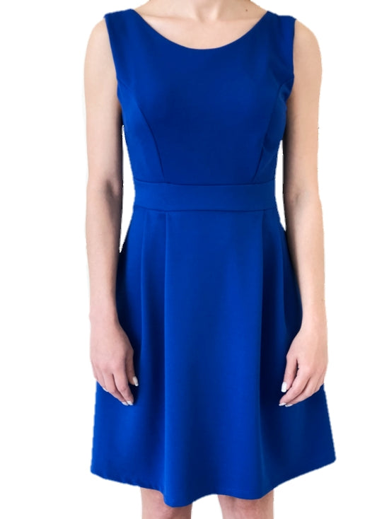 girl-wears-a-mini-blue-dress-with-a-bow-at-the-back-white-background