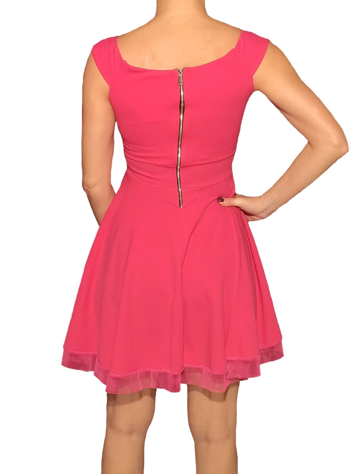 a-woman-wears-a-pink-dress-with-tul-back-side