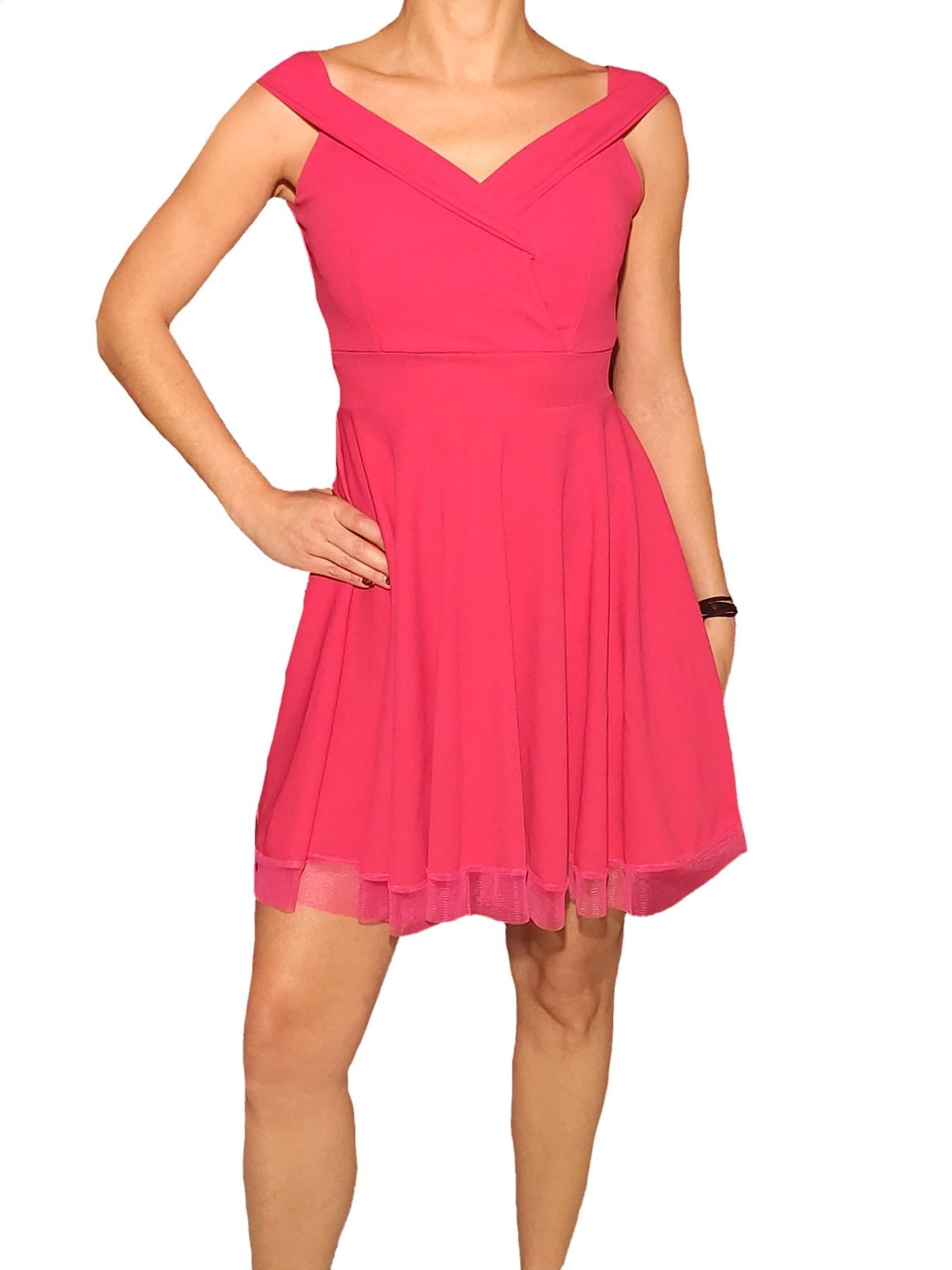 a-woman-wears-a-pink-dress-with-tul-front-side