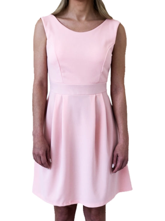girl-wears-a-mini-pink-dress-with-a-bow-at-the-back-white-background