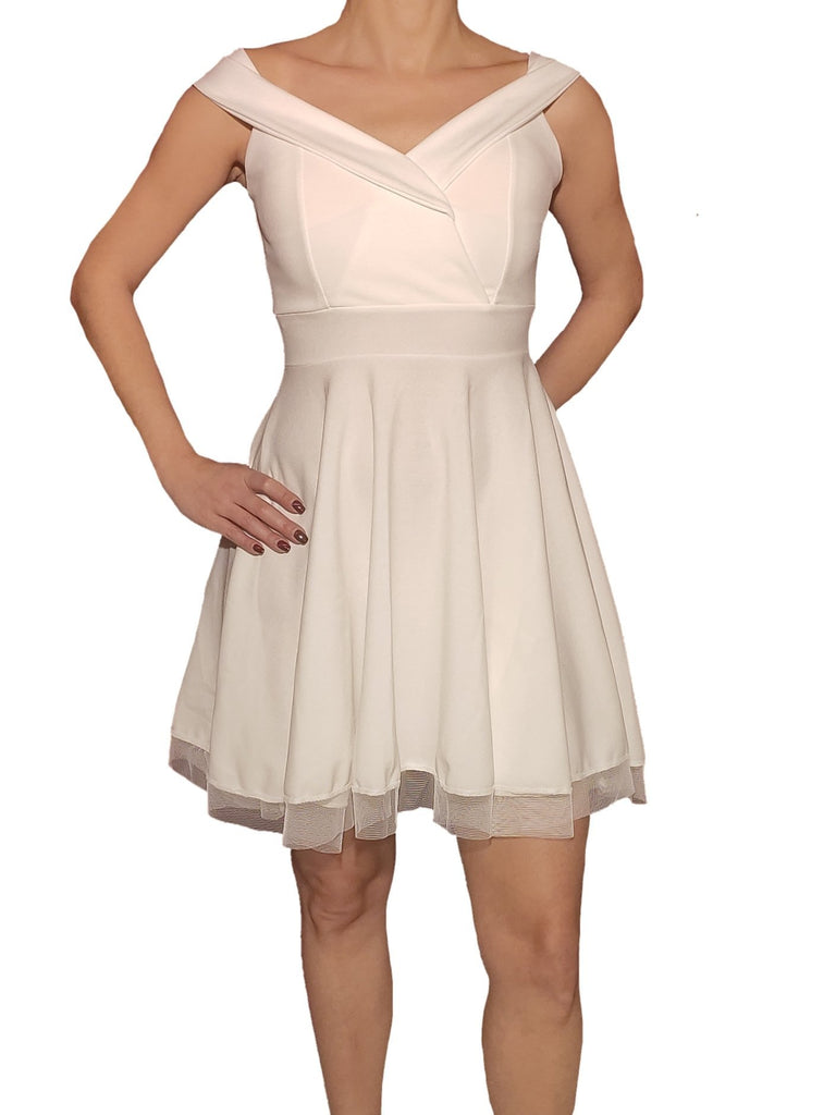 a-woman-wears-a-white-dress-with-tul-front-side
