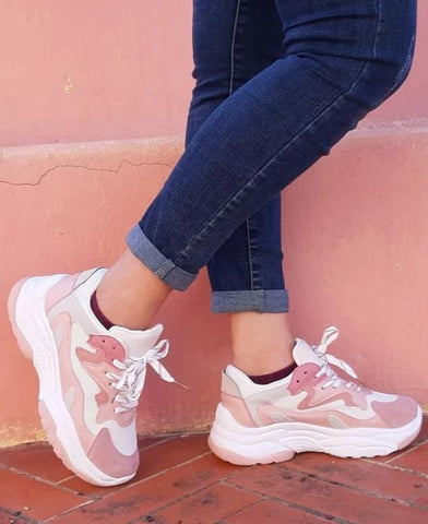 girl-wears-pink-and-white-sneakers