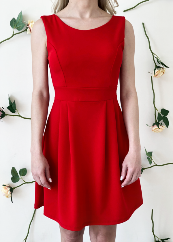 blonde-girl-wears-red-dress-with-a-bow-back