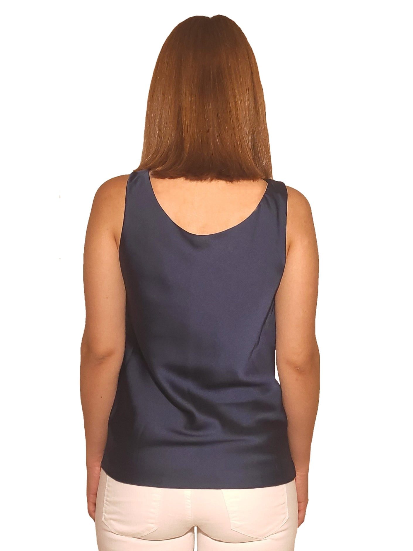 brunet-girl-wears-a-sleeveless-blue-blouse-with-satin-texture-back