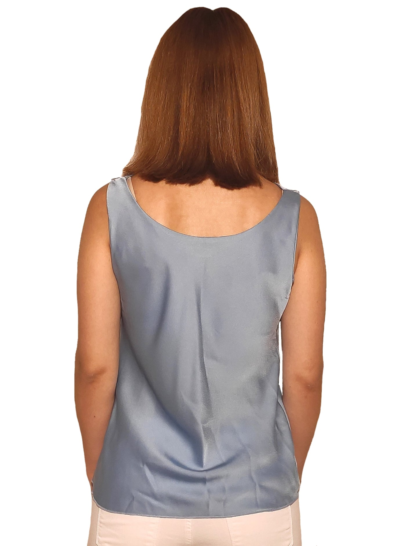 brunet-girl-wears-a-sleeveless-tirquoise-blouse-with-satin-texture-back