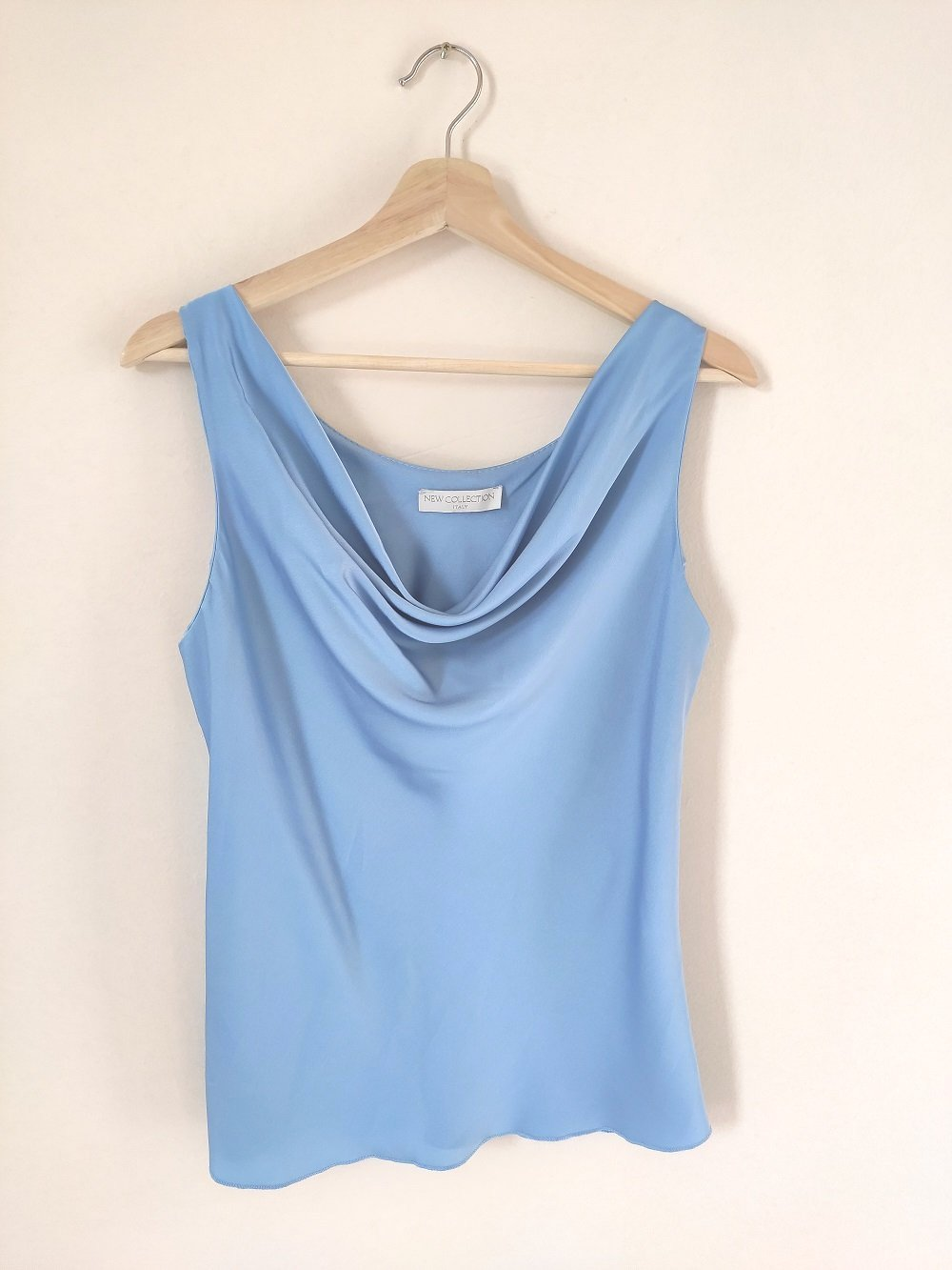 tirquoise-sleeveless-blouse-satin-front-on-a-hanger