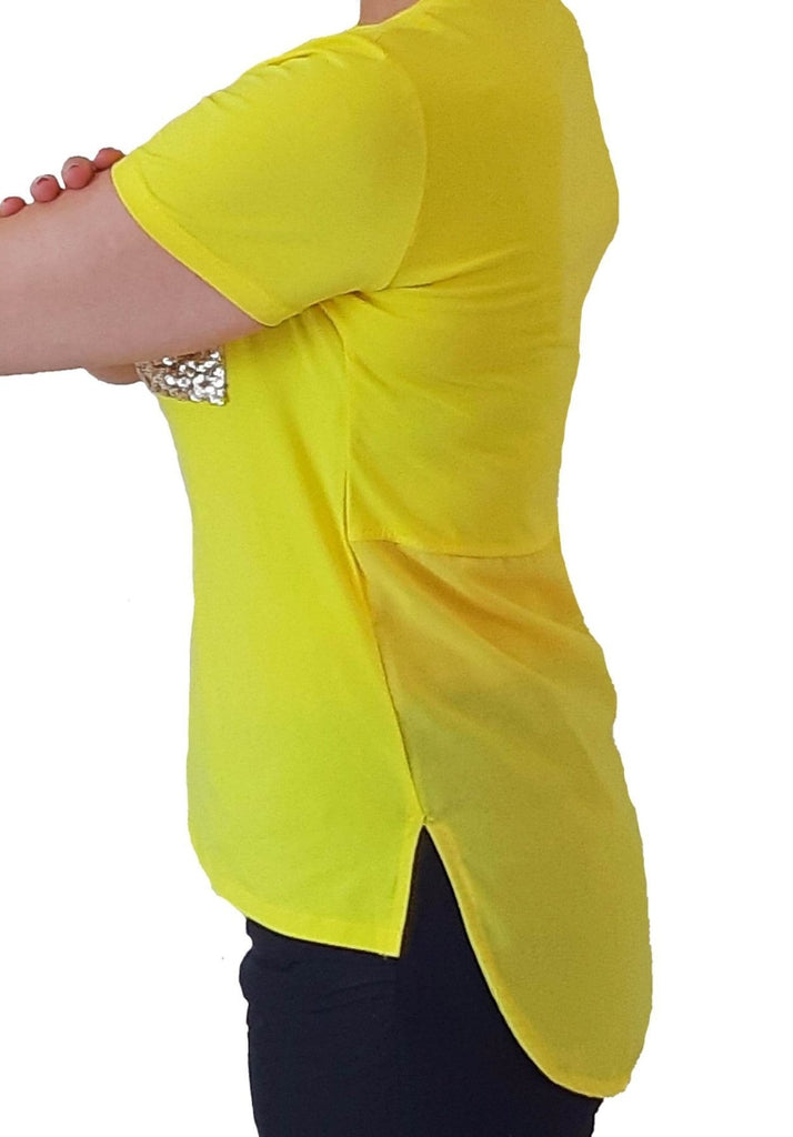 woman-wears-yellow-tshirt-with-silver-sequins-left-side
