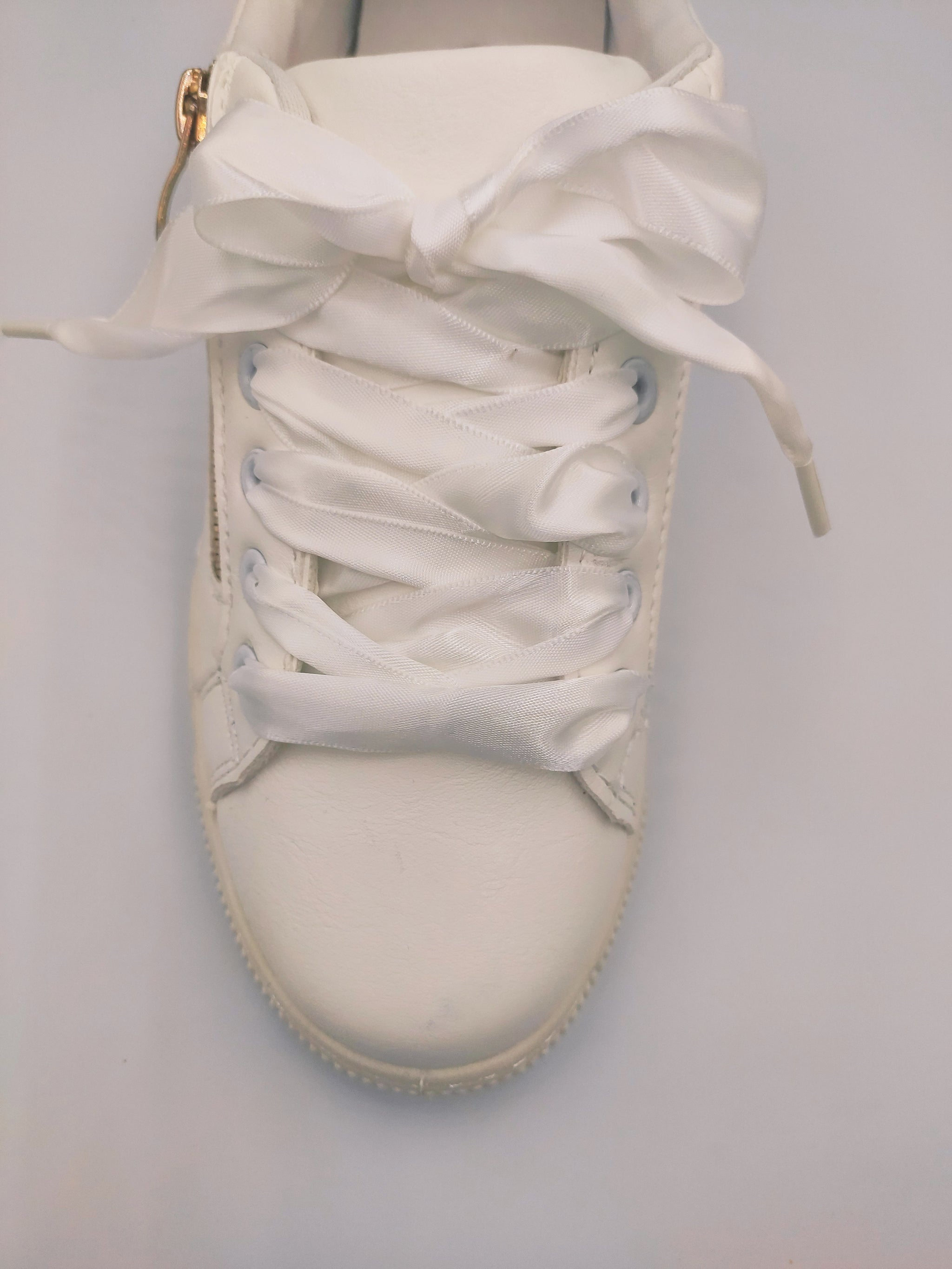white-sneakers-with-gold-raser-side-3-grey-background