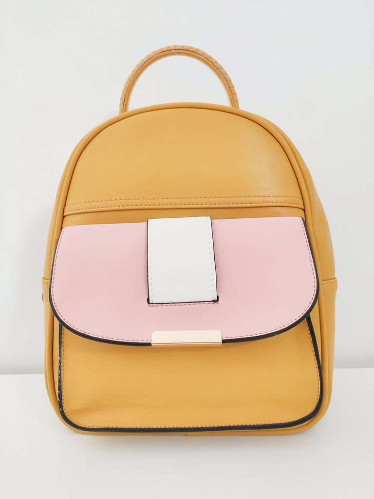 yellow-and-pink-backpack-frontside-in-white-background