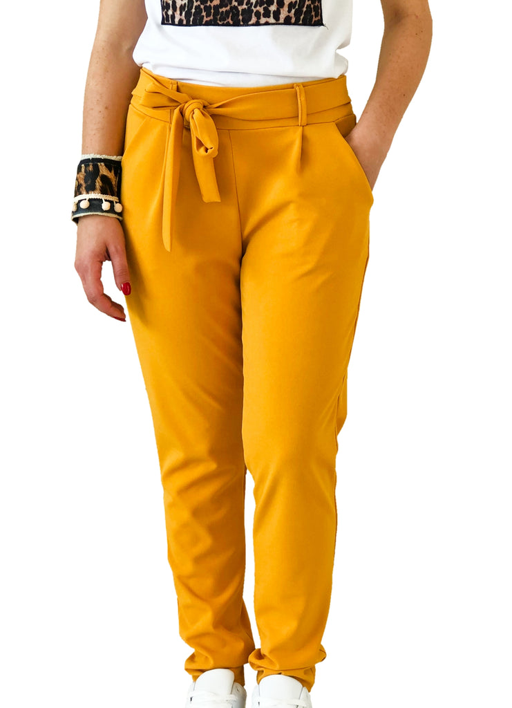 model-wears-a-yellow-trouser-with-bow-white-background