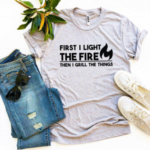 First I Light The Fire T-shirt - A Woman Knows Best