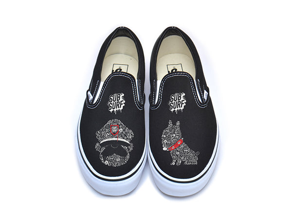 799196ca4f SUBSURF® Black Book- Guard and Dog Slip On Vans – The Ave Los Angeles