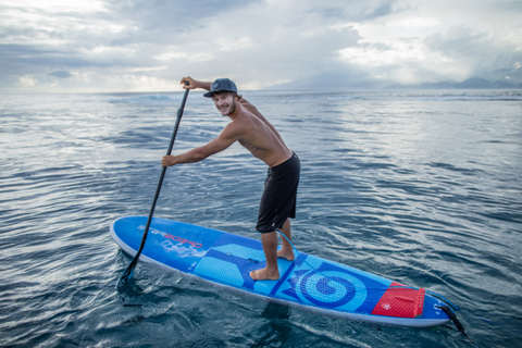 paddle boarding with a smile