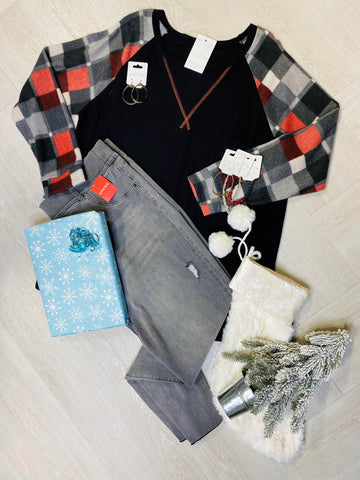 Plaid and black tunic tee and grey jeggings.